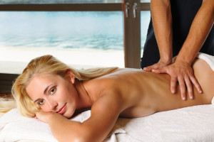 The beautiful young woman getting a massage