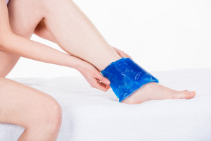 woman with ice pack on ankle